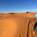 Riding a camel into the Moroccan desert