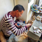 Driss making zellij tile.