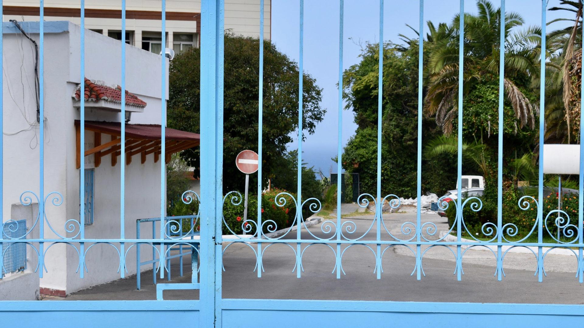 Outside the gates of Hopital Kortobi